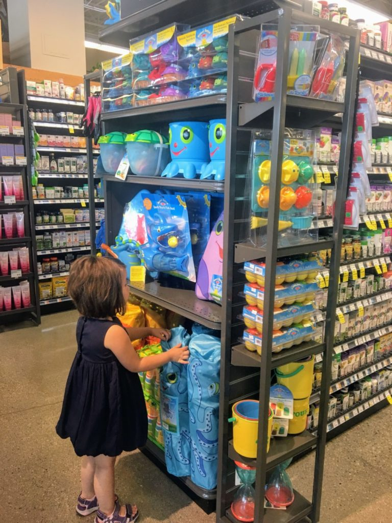 My niece checking out some of the pool toys.