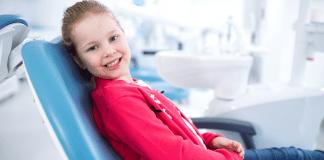 Title Image:Smiling Girl at Dentist