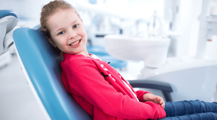 Title Image:Smiling Girl at Dentist